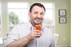 Bearded guy is fond of cleansing smoothie Royalty Free Stock Image