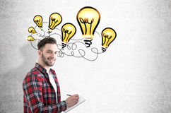 Bearded guy and light bulbs Royalty Free Stock Images
