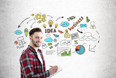 Bearded guy with notebook and business idea Stock Image