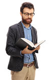 Bearded guy reading a book Stock Images