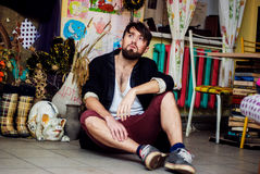Bearded guy sit on the floor. Stylish bearded guy sit on the floor Royalty Free Stock Photos