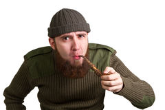 Bearded guy smoking a pipe Stock Image
