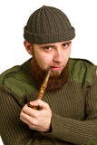 Bearded guy smoking a pipe Stock Photos