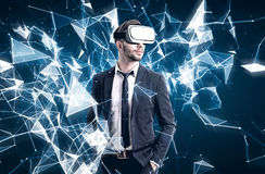 Bearded guy in VR glasses and polygons Stock Images