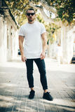 Bearded guy wearing white blank t-shirt and blue Royalty Free Stock Photography
