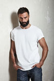 Bearded guy wearing white t-shirt Stock Image