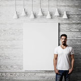 Bearded guy and white poster on wood wall Stock Images