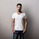 Bearded handsome guy in white blank t-shirt Royalty Free Stock Image