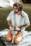 Bearded handsome man sitting with acoustic drum
