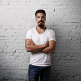 Bearded handsome man wearing white t-shirt Stock Photography