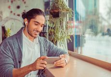 Bearded happy man looking at phone smiling royalty free stock images