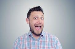 Bearded happy man positive, portrait. On background Royalty Free Stock Photo