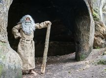 Bearded hermit in a cave Royalty Free Stock Photos