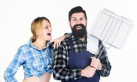 Bearded hipster and cheerful girl hold cooking grilling utensils white background. Essential barbecue dishes. Make it royalty free stock photo
