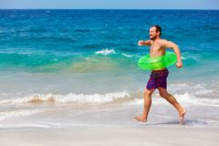 Bearded hipster in inflatable ring have fun on beach vacation Royalty Free Stock Photography