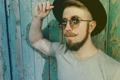 Bearded hipster man in hat and sunglasses stock photography
