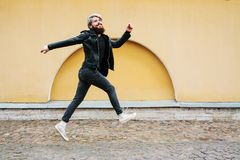 Bearded hipster with nose ring in leather jacket. Outdoor Stock Images