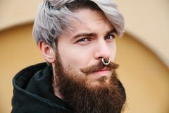 Bearded hipster with nose ring in leather jacket. Outdoor Stock Photo