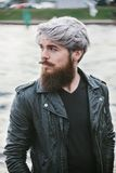 Bearded hipster with nose ring in leather jacket. Outdoor Stock Photography