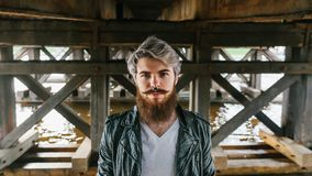 Bearded hipster with nose ring in leather jacket. Outdoor Royalty Free Stock Photo