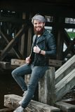 Bearded hipster with nose ring in leather jacket. Outdoor Stock Photos