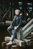 Bearded hipster with nose ring in leather jacket. Outdoor Royalty Free Stock Photos