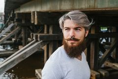 Bearded hipster with nose ring  outdoor. Bearded hipster with nose ring outdoor street Stock Photo