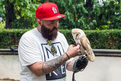 Bearded hipster with an owl in his hand Royalty Free Stock Photos