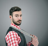 Bearded hipster pulling his suspenders looking at camera Stock Photo