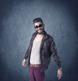 Bearded hipster standing in elegant clothes Stock Images