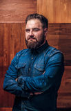 Bearded hipster on a wooden texture stock photo