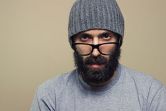 Bearded hipster young man with glasses Stock Photos