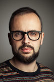 Bearded hiptser. Serious bearded hipster with black glasses Royalty Free Stock Photo