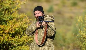 Bearded hunter spend leisure hunting. Focus and concentration of experienced hunter. Hunting masculine hobby concept. Man brutal gamekeeper nature background stock photos