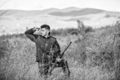 Bearded hunter spend leisure hunting. Hunter hold rifle. Focus and concentration of experienced hunter. Hunting and. Trapping seasons. Man brutal gamekeeper stock images