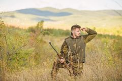 Bearded hunter spend leisure hunting. Hunter hold rifle. Focus and concentration of experienced hunter. Hunting and. Trapping seasons. Man brutal gamekeeper royalty free stock photos