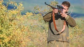 Bearded hunter spend leisure hunting. Hunting equipment for professionals. Hunting is brutal masculine hobby. Man aiming stock photography