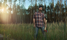 Bearded Lumberjack in Hat holding a big Ax in Hand Royalty Free Stock Photo