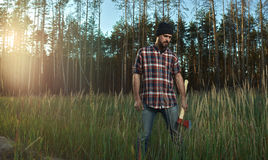 Bearded Lumberjack in Hat looking down Stock Photos
