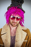 Bearded Lunatic. Pink haired bearded bum lunatic man with cool sunglasses Stock Photo