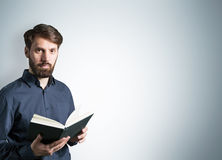 Bearded male with book Stock Photo
