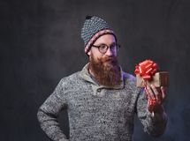 Bearded male holds Christmas gifts. royalty free stock photo