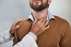 Bearded male patient staing at doctor office stock image