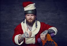 Bearded male in Santas New Year costume. Royalty Free Stock Image