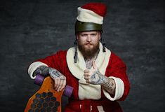 Bearded male in Santas New Year costume. Royalty Free Stock Images