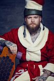 Bearded male in Santas New Year costume. Royalty Free Stock Photos