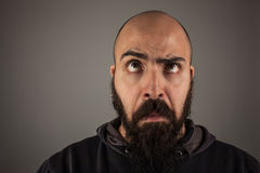 Bearded man. Bearded bald man doubtfully thinking with a funny expression Royalty Free Stock Image