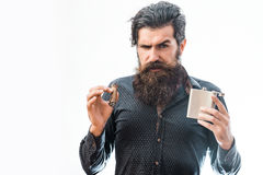 Bearded man with alcoholic beverage Stock Photography