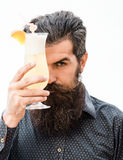 Bearded man with alcoholic beverage Stock Images