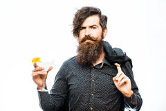 Bearded man with alcoholic beverage Royalty Free Stock Photography